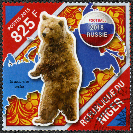 NIGER - CIRCA 2015: A stamp printed in Niger shows bear, 2018 Football World Cup Russia, circa 2015