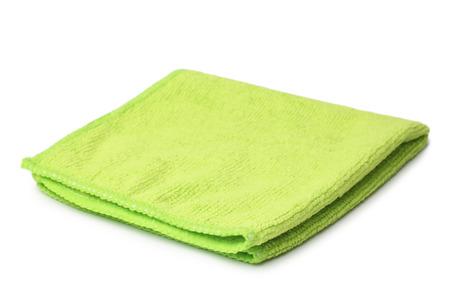 Paño de microfibra verde sobre fondo blanco Foto de archivo