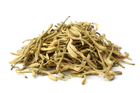 Dried honeysuckle flower tea (Jin Yin Hua) on white background