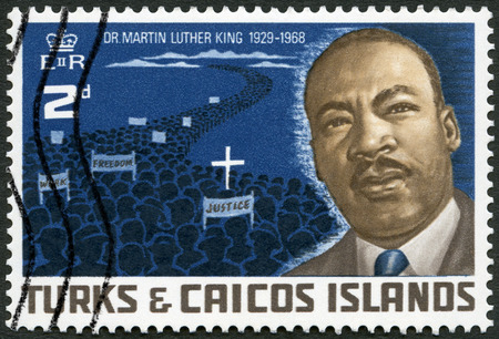 TCI - CIRCA 1968: A stamp printed in The Turks and Caicos Islands shows Dr. Martin Luther King, Jr. (1929-1968) and Protest March of 1968, American civil rights leader, circa 1968