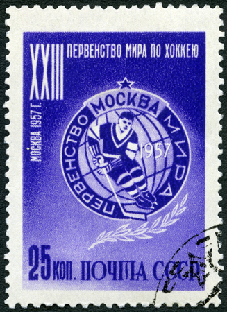 USSR - CIRCA 1957: A stamp printed in USSR shows emblem, series dedicated 23rd Ice Hockey World Championship IIHF in Moscow, circa 1957 Editorial