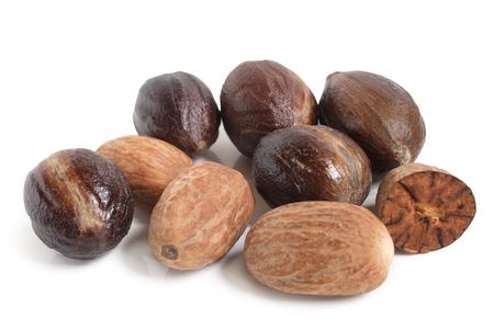 Nutmeg on white background Stock Photo