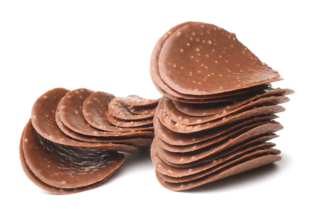 Chocolate chips on white background Stock Photo
