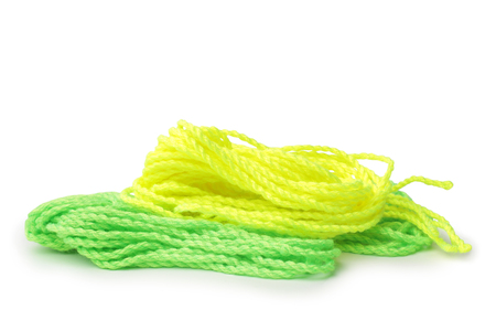 Yellow and green strings for yo-yo toy on white background