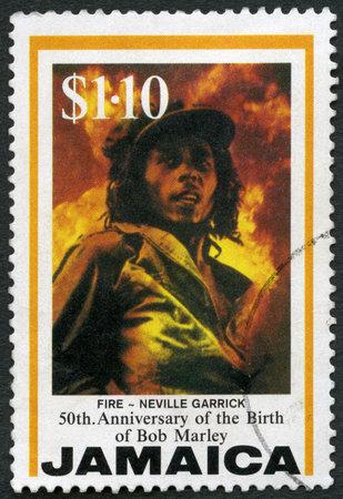 JAMAICA - CIRCA 1995: A stamp printed in Jamaica shows portrait of Robert Nesta Bob Marley (1945-1981), Fire, by Neville Garrick, Reggae Musician, circa 1995