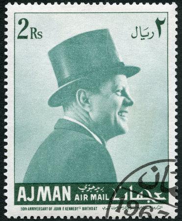 AJMAN - CIRCA 1967: A stamp printed in Ajman shows John F. Kennedy (1917-1963), circa 1967