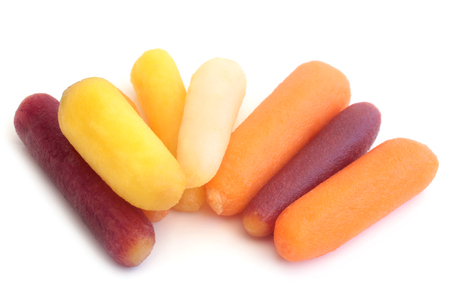 Baby rainbow carrots on white background 스톡 콘텐츠