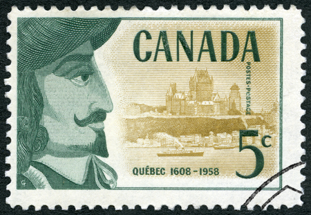 CANADA - CIRCA 1958: A stamp printed in Canada shows Samuel de Champlain (1574-1635) and view of Quebec, 350th Anniversary of Founding of Quebec, circa 1958 Stok Fotoğraf - 120167303
