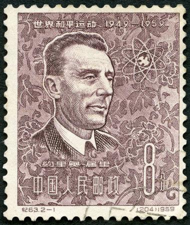 CHINA - CIRCA 1959: A stamp printed in China shows Jean Frederick Joliot Curie (1900-1958), circa 1959 Redakční
