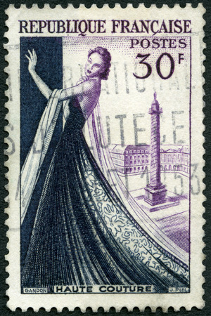 FRANCE - CIRCA 1953: A stamp printed in France shows Mannequin, Haute couture, Dressmaking industry of France, circa 1953