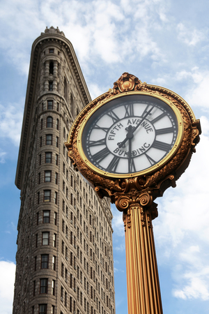 NEW YORK, USA - JULY 06, 2018: Flatiron building and clock in focus