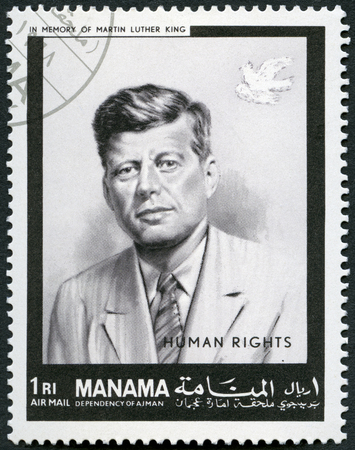 MANAMA - CIRCA 1969: A stamp printed in Manama shows Portrait of John Fitzgerald Kennedy (1917-1963), 35th president of the United States, human rights, in memory of Martin Luther King, circa 1969