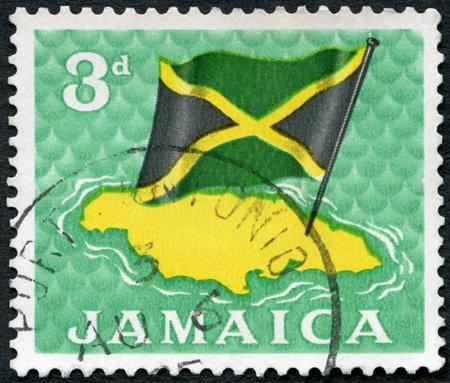 JAMAICA - CIRCA 1964: A stamp printed in Jamaica shows Flag over map, circa 1964