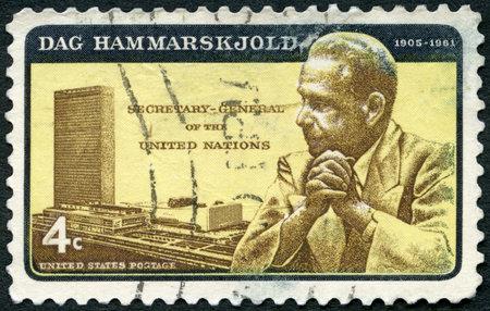 UNITED STATES OF AMERICA - CIRCA 1962: A stamp printed in USA shows portrait of Dag Hjalmar Agne Carl Hammarskjold (1905-1961) and UN Headquarters, circa 1962