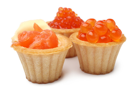 Tartlets with red caviar and salted salmon on white background Archivio Fotografico
