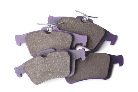 Set of brake pads on white background