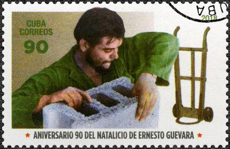 CUBA - CIRCA 2018: A stamp printed in Cuba shows commander Ernesto Guevara de la Serna Che Guevara (1928-1967) and brick stone, circa 2018