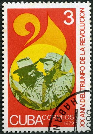 CUBA - CIRCA 1979: A stamp printed in Cuba shows commander Fidel Alejandro Castro Ruz (1926-2016) and soldier, Triumph of the Revolution, 20th anniversary, circa 1979 Reklamní fotografie - 120168653