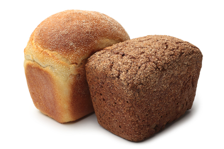 Loaves of white and rye bread on white background