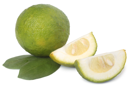 Unripe orange with green leaves on white background