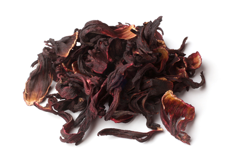 Dried hibiscus calyces on white background