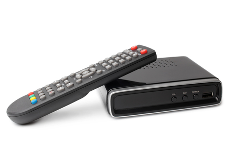Digital TV tuner with remote control on white background Stockfoto