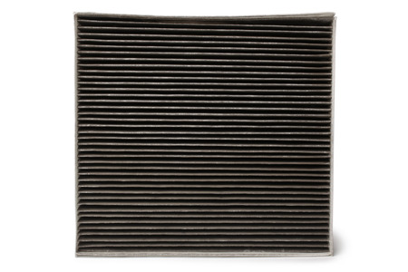 Dirty cabin air filter for car on white background