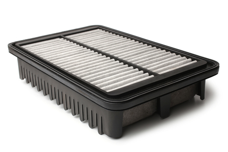 Dirty air filter for car on white background