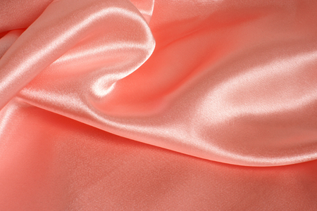 Pink smooth satin textile, for backgrounds or textures