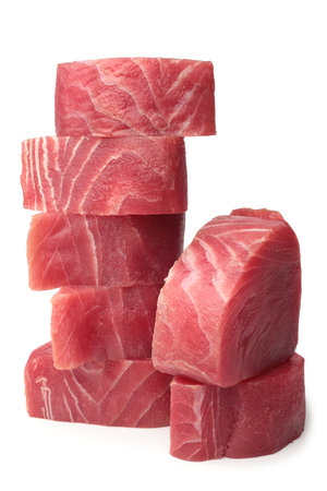 Slices of raw tuna fish meat on white background