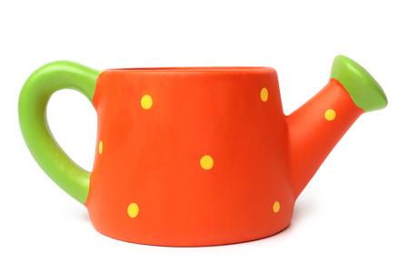 Ceramic watering can on white background