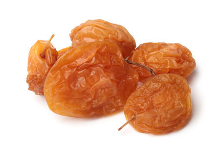 Dried cherry plums on white background