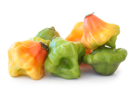 Scotch bonnet peppers on white background