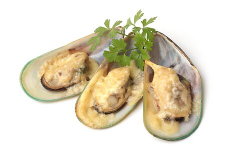 Baked mussels with cheese on white background