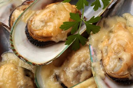 Baked mussels with cheese, for backgrounds or textures Banque d'images