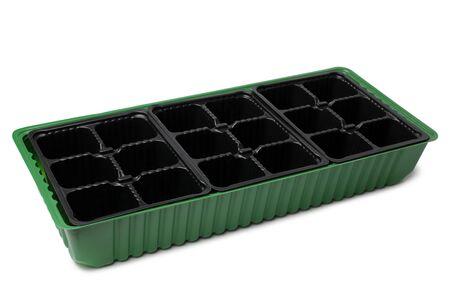 Plastic pots for seedlings on white background