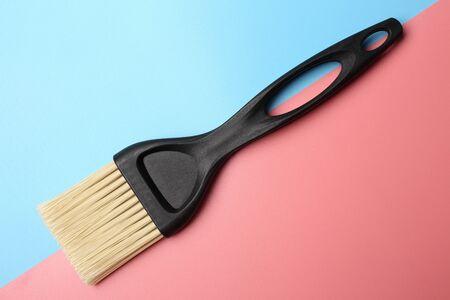 Paintbrush on blue-pink background 写真素材