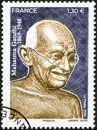 Paris, France - October 07, 2019: A stamp printed in France shows portrait of Mahatma Mohandas Karamchand Gandhi (1869-1948), circa 2019 報道画像