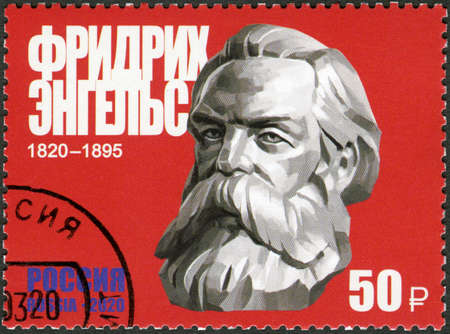 Moscow, Russia - March 05, 2020: A stamp printed in Russia shows Friedrich Engels (1820-1895), 200th Birth Anniversary, Philosopher and Economist, circa 2020