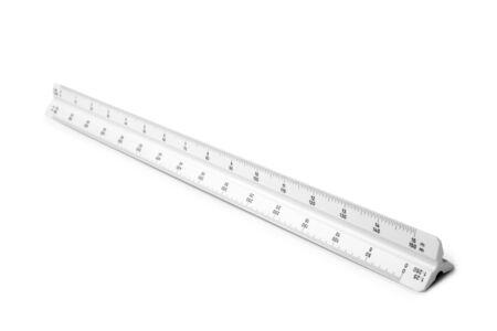 Triangular scale ruler on white background