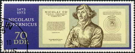 MOSCOW, RUSSIA - NOVEMBER 19, 2018: A stamp printed in GDR shows Nicolaus Copernicus (1473-1543), Title Page, 500th anniversary of the birth, astronomer, circa 1973 Editorial
