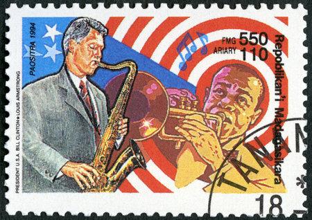 MALAGASY REPUBLIC - CIRCA 1994: A stamp printed in Madagascar shows Bill William Jefferson Clinton Blythe (born 1946) and Louis Daniel Armstrong (1901-1971), series PhilaKorea, circa 1994