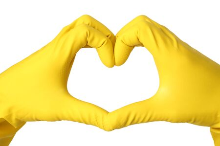 Heart built from the hands in yellow rubber gloves isolated on white background Фото со стока