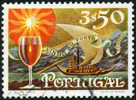 PORTUGAL - CIRCA 1970: A stamp printed in Portugal shows Glass of wine and barge with barrels on River Douro, series Publicity for port wine export, circa 1970