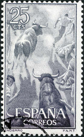 SPAIN - CIRCA 1960: A Stamp printed in Spain shows Running with the bulls, Pamplona encierro, corrida, Fighting with muleta, circa 1960