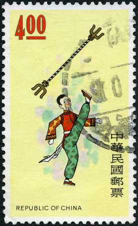 CHINA - CIRCA 1975: A stamp printed in China shows Acrobat with Iron Rod, circa 1975