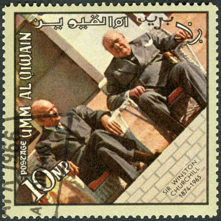 UMM AL-QUWAIN - CIRCA 1965: A stamp printed in Umm al-Quwain shows Sir Winston Leonard Spencer Churchill (1874-1965) and Dwight D. Eisenhower (1890-1969), memoreal state funeral, circa 1965