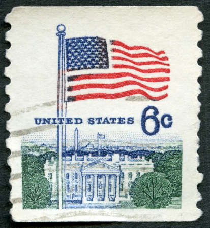 USA - CIRCA 1967: A stamp printed in the USA shows an American Flag flying in the breeze over White House, Flag Issue, circa 1967 新闻类图片