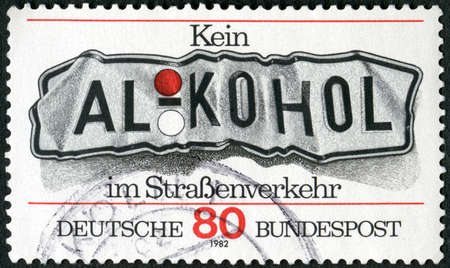 GERMANY - CIRCA 1982: A stamp printed in Germany shows word alcohol, Do not Drink and Drive, circa 1982 新闻类图片