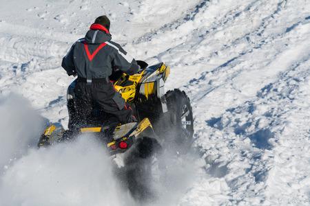 quad: Quad bike in a field in winter